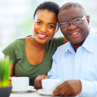 adult woman and senior man wearing eye glasses smiling