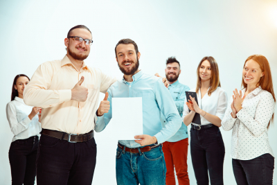 Boss approving and congratulating young successful employee