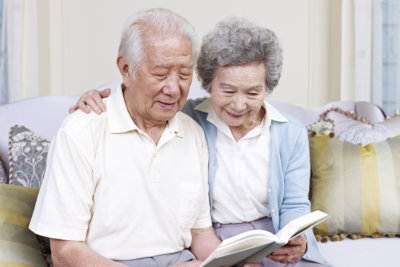 Asian couple reading together