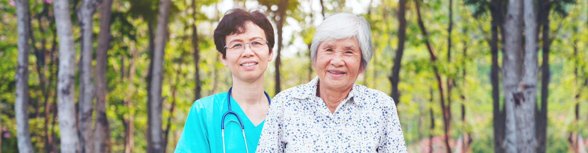 health worker wearing eyeglasses and senior woman smiling