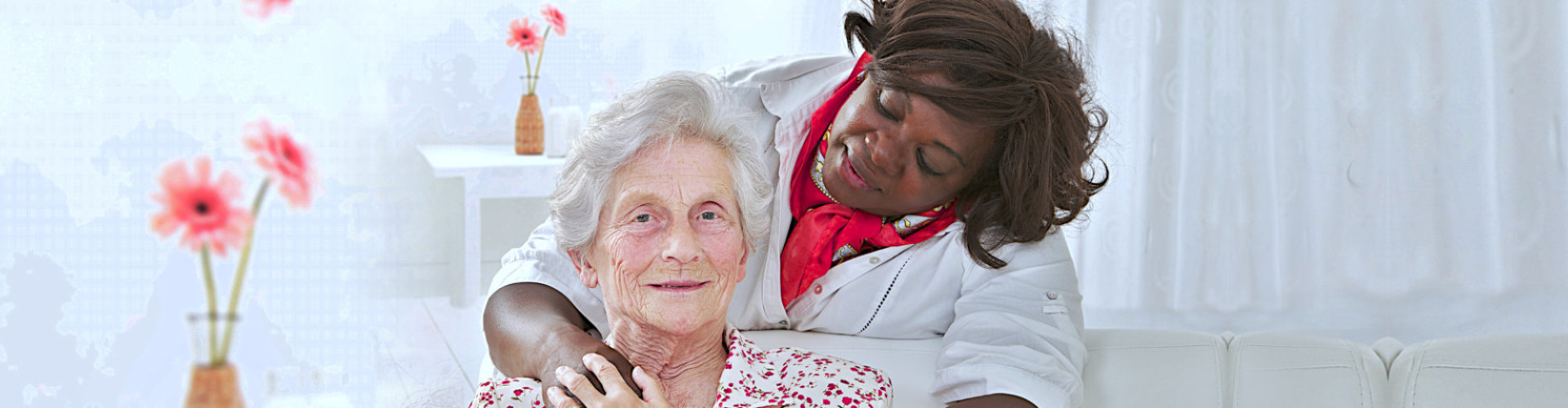 female nurse holding the hands of senior woman smiling